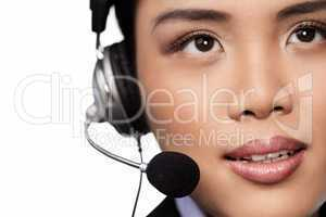 Closeup of an Asian lady wearing a headset