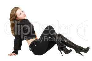 The young beautiful woman in black suit. Isolated