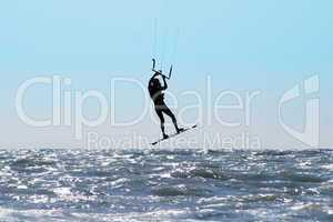 Silhouette of kite surfer in a sea