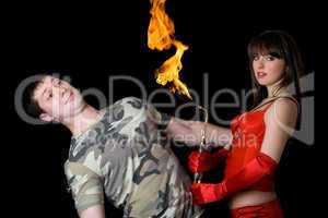 Young woman with a gas torch and scared man