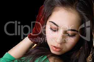 Portrait of the girl with closed eyes. Isolated