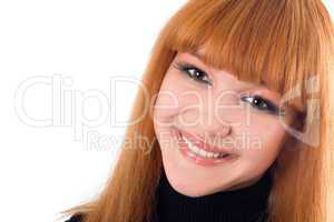 Portrait of the smiling redheaded woman