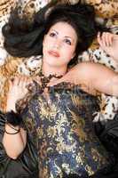 Portrait of a dreamy brunette in a corset
