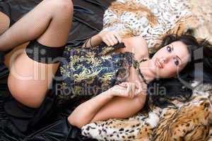 Smiling beautiful woman in a corset
