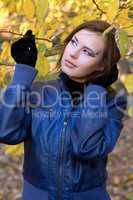 beautiful girl amongst the autumn leaves