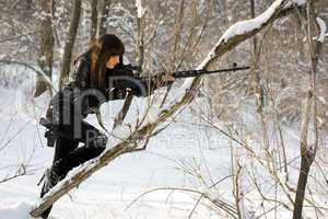 Young woman with a sniper rifle
