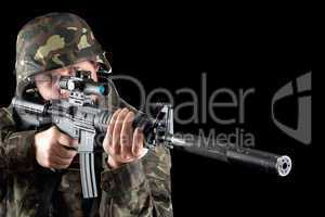 Armed man taking aim