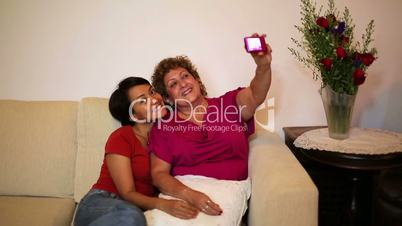 mother daughter taking own picture