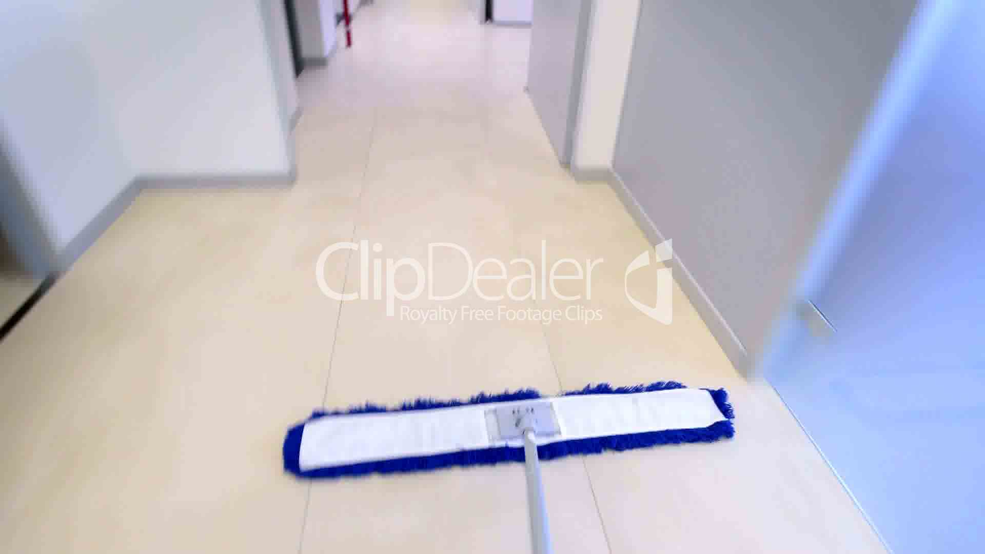 Timelapse Of Professional Cleaner Wiping Floor With Broom