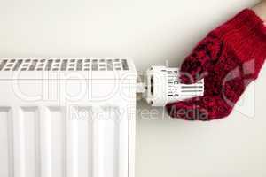Hand holding radiator thermostat