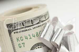 Roll of One Hundred Dollar Bills Tied Silver Bow on White