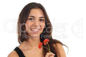 Teen girl with a flower smiling