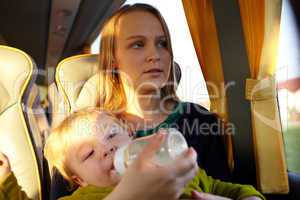 Mother with kid in the bus.