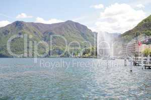 Mountainside villas and appartments at lake with waterfountain i