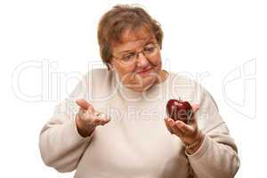 Confused Senior Woman Holding Apple and Vitamins