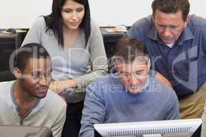 People looking at computer monitor