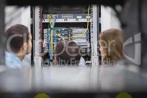 Technicians viewing a server