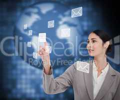 Brunette businesswoman pressing envelope on touch screen