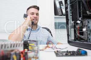 Hardware professional sitting by an open cpu while on call