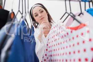 Woman selecting clothing