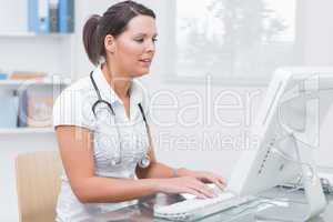 Female doctor using computer at clinic