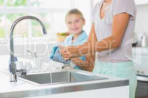 Mother doing the washing up
