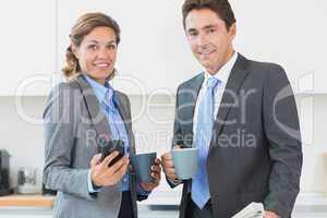 Power couple having coffee before work