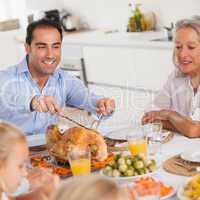 Man carving the thanksgiving turkey