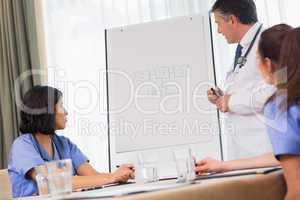 Doctor presenting figures