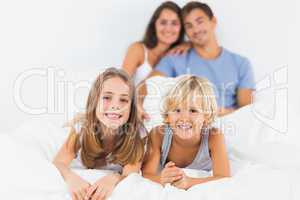Children lying on the bed