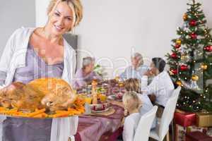 Proud mother showing roast turkey
