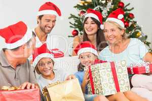 Happy family at christmas swapping gifts