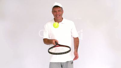 Tennis man juggling with his racket