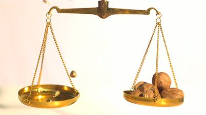 Gold nuggets falling on weighing scale