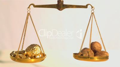 Gold falling onto weighing scales