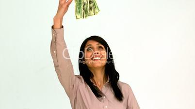 Enjoying woman throwing bills