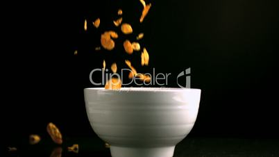 Cereal pouring into a bowl