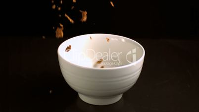 Brown cereal pouring into a bowl