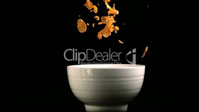 Cereal flakes falling in a bowl
