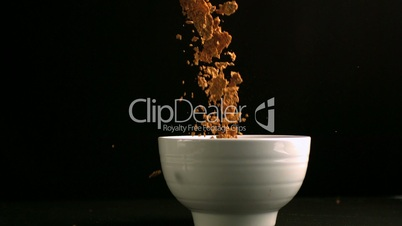 Brown cereals pouring in a bowl