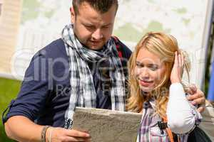 Couple looking at map on city break