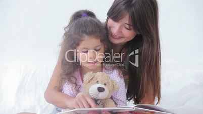 Mother and daughter reading a storybook