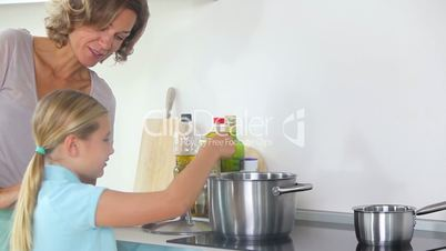 Mother and daughter preparing dinner