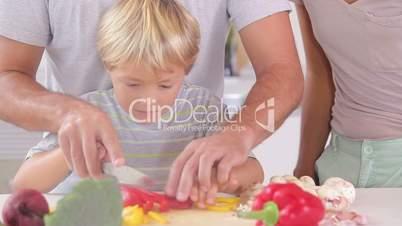 Happy family preparing vegetables