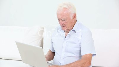 Old man using a laptop