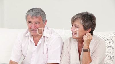 Old couple talking and listening sitting