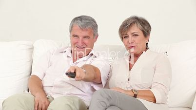 Old couple watching TV