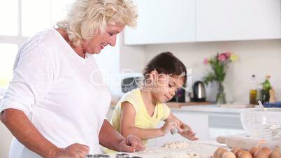 Child and granny preparing pastry