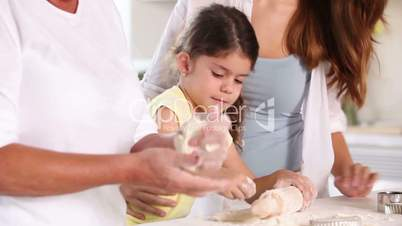 Granny mother and child making cookies