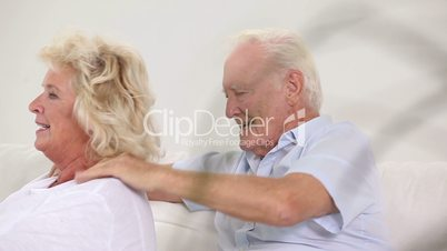 Grandpa massaging his wife
